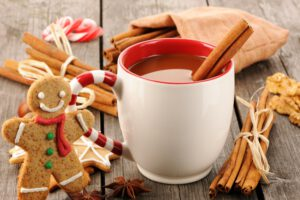 hot-cider-with-cinnamon-sticks-and-a-decorated-gingerbread-cookie